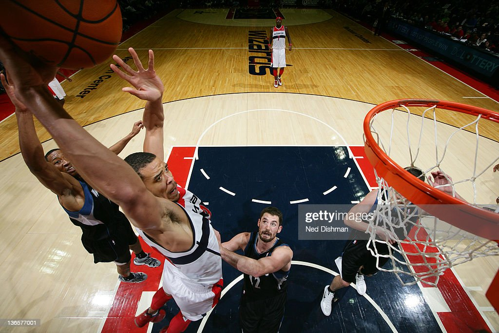 JaVale McGee #34 of the Washington Wizards dunks against <a gi-track='captionPersonalityLinkClicked' href=/galleries/search?phrase=Kevin+Love&family=editorial&specificpeople=4212726 ng-click='$event.stopPropagation()'>Kevin Love</a> #42 of the Minnesota Timberwolves during the game at the Verizon Center on January 8, 2012 in Washington, DC.