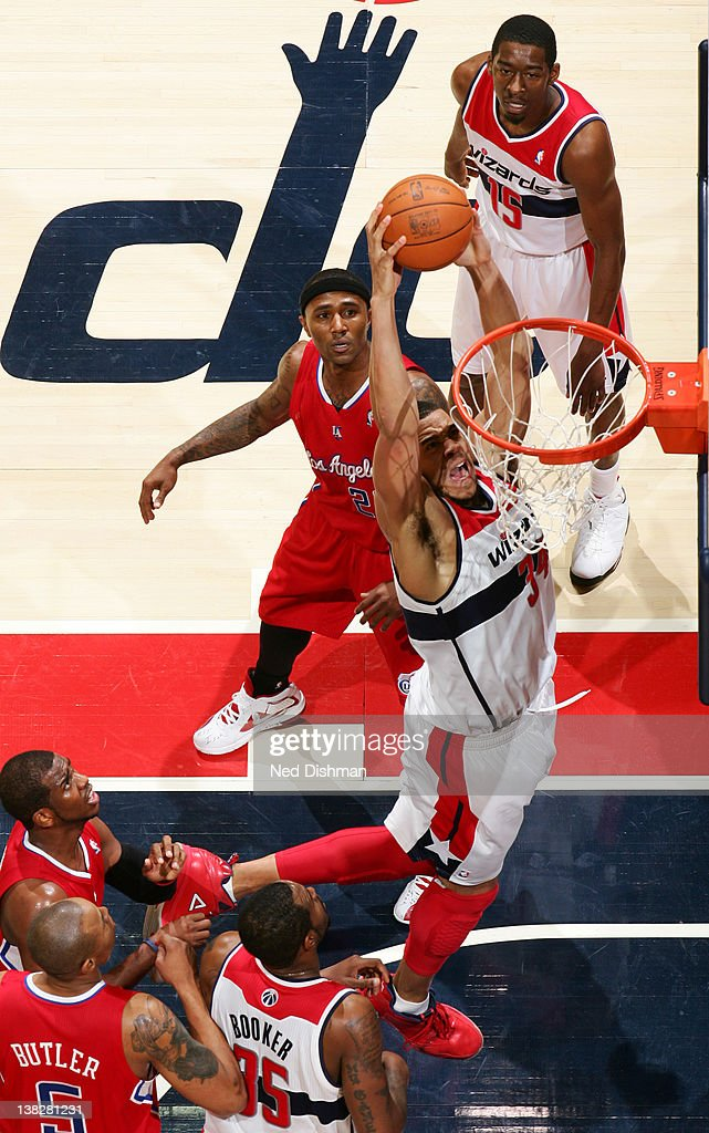 <a gi-track='captionPersonalityLinkClicked' href=/galleries/search?phrase=JaVale+McGee&family=editorial&specificpeople=4195625 ng-click='$event.stopPropagation()'>JaVale McGee</a> #34 of the Washington Wizards dunks against Mo Williams #25 of the Los Angeles Clippers during the game at the Verizon Center on February 4, 2012 in Washington, DC.