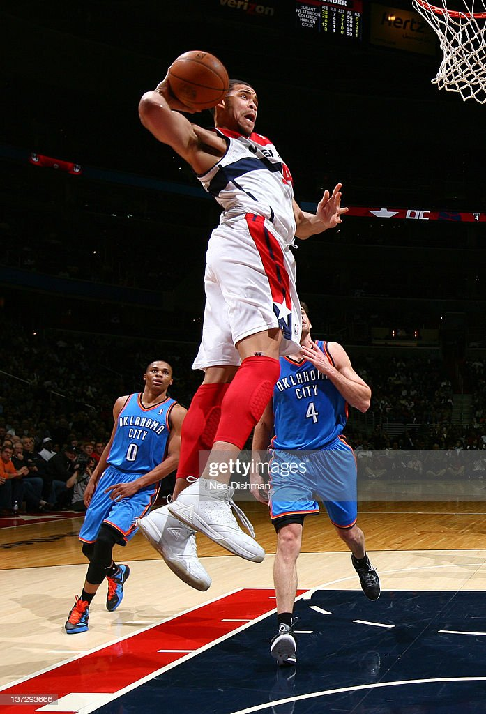 <a gi-track='captionPersonalityLinkClicked' href=/galleries/search?phrase=JaVale+McGee&family=editorial&specificpeople=4195625 ng-click='$event.stopPropagation()'>JaVale McGee</a> #34 of the Washington Wizards dunks against <a gi-track='captionPersonalityLinkClicked' href=/galleries/search?phrase=Nick+Collison&family=editorial&specificpeople=202843 ng-click='$event.stopPropagation()'>Nick Collison</a> #4 of the Oklahoma City Thunder during the game at the Verizon Center on January 18, 2012 in Washington, DC.