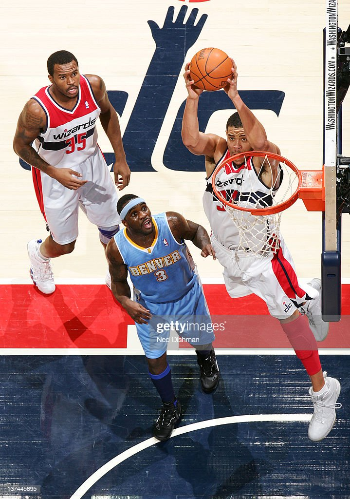 <a gi-track='captionPersonalityLinkClicked' href=/galleries/search?phrase=JaVale+McGee&family=editorial&specificpeople=4195625 ng-click='$event.stopPropagation()'>JaVale McGee</a> #34 of the Washington Wizards dunks against <a gi-track='captionPersonalityLinkClicked' href=/galleries/search?phrase=Ty+Lawson&family=editorial&specificpeople=4024882 ng-click='$event.stopPropagation()'>Ty Lawson</a> #3 of the Denver Nuggets during the game at the Verizon Center on January 20, 2012 in Washington, DC.