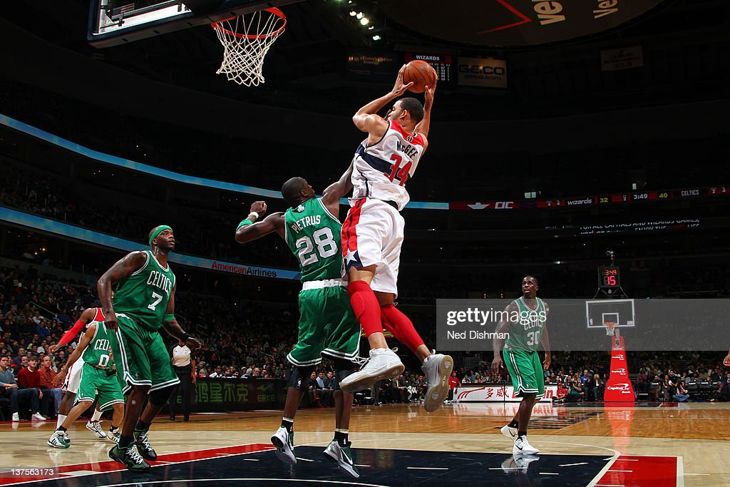 <a gi-track='captionPersonalityLinkClicked' href=/galleries/search?phrase=JaVale+McGee&family=editorial&specificpeople=4195625 ng-click='$event.stopPropagation()'>JaVale McGee</a> #34 of the Washington Wizards goes to the basket against <a gi-track='captionPersonalityLinkClicked' href=/galleries/search?phrase=Mickael+Pietrus&family=editorial&specificpeople=202910 ng-click='$event.stopPropagation()'>Mickael Pietrus</a> #28 of the Boston Celtics during the game between the Washington Wizards and the Boston Celtics at the Verizon Center on January 22, 2012 in Washington, DC.