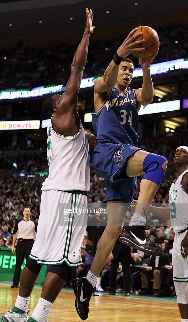 JaVale McGee of the Washington Wizards heads for the basket as Kendrick Perkins of the Boston Celtics defends on March 7 2010 at the TD Garden in...