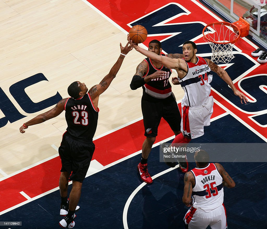 <a gi-track='captionPersonalityLinkClicked' href=/galleries/search?phrase=JaVale+McGee&family=editorial&specificpeople=4195625 ng-click='$event.stopPropagation()'>JaVale McGee</a> #34 of the Washington Wizards rebounds against <a gi-track='captionPersonalityLinkClicked' href=/galleries/search?phrase=Marcus+Camby&family=editorial&specificpeople=201722 ng-click='$event.stopPropagation()'>Marcus Camby</a> #23 of the Portland Trail Blazers at the Verizon Center on March 10, 2012 in Washington, DC.