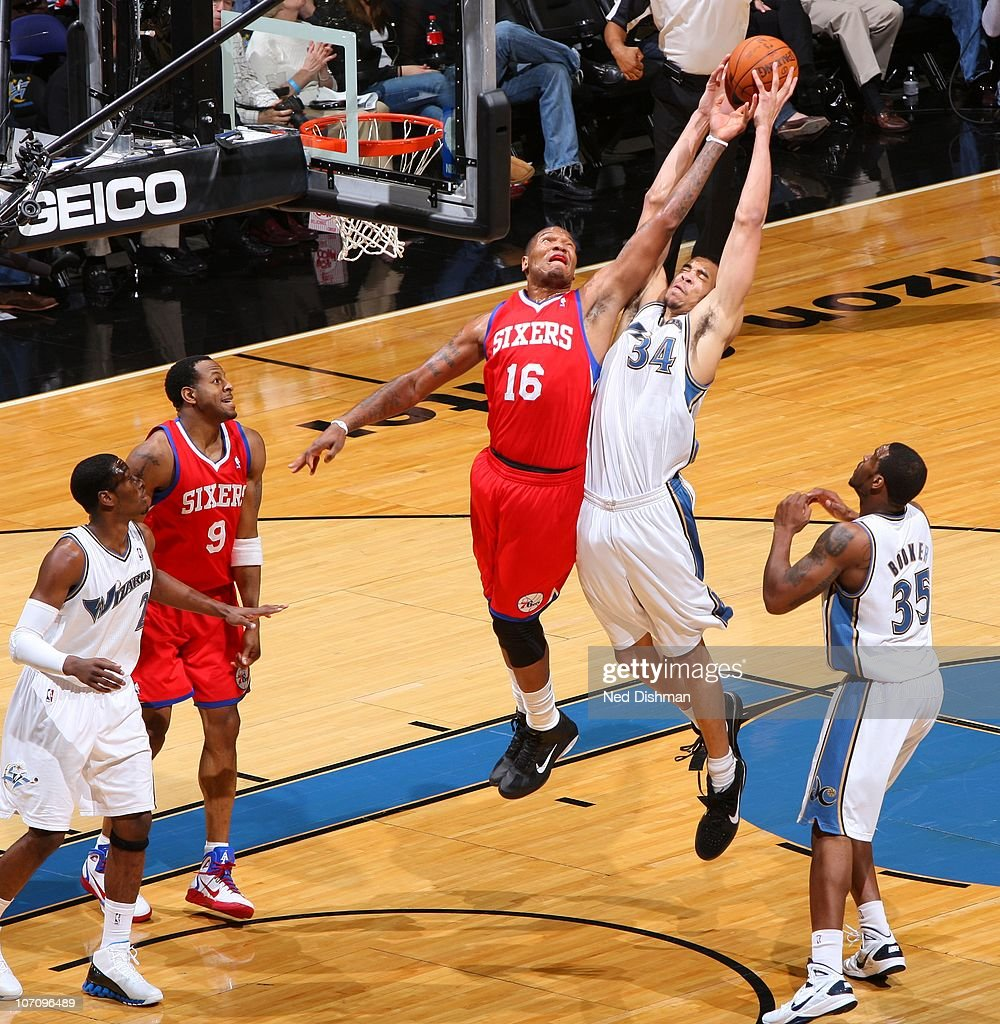 <a gi-track='captionPersonalityLinkClicked' href=/galleries/search?phrase=JaVale+McGee&family=editorial&specificpeople=4195625 ng-click='$event.stopPropagation()'>JaVale McGee</a> #34 of the Washington Wizards rebounds against <a gi-track='captionPersonalityLinkClicked' href=/galleries/search?phrase=Marreese+Speights&family=editorial&specificpeople=4187263 ng-click='$event.stopPropagation()'>Marreese Speights</a> #16 of the Philadelphia 76ers at the Verizon Center on November 23, 2010 in Washington, DC.