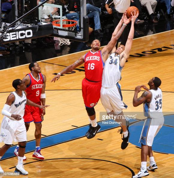 JaVale McGee of the Washington Wizards rebounds against Marreese Speights of the Philadelphia 76ers at the Verizon Center on November 23 2010 in...