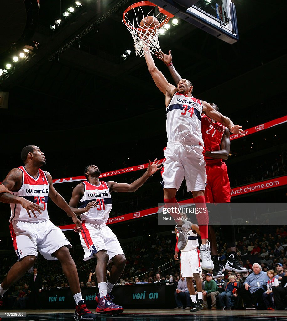 JaVale McGee #34 of the Washington Wizards shoots against Samuel Dalembert #21 of the Houston Rockets during the game at the Verizon Center on January 16, 2012 in Washington, DC.