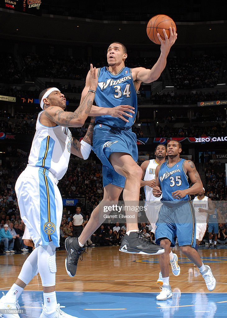 Javale Mcgee #34 of the Washington Wizards takes a shot against <a gi-track='captionPersonalityLinkClicked' href=/galleries/search?phrase=Kenyon+Martin&family=editorial&specificpeople=201522 ng-click='$event.stopPropagation()'>Kenyon Martin</a> #4 of the Denver Nuggets on March 25, 2011 at the Pepsi Center in Denver, Colorado.