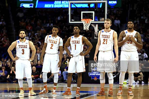 Javan Felix Demarcus Holland Isaiah Taylor Connor Lammert and Cameron Ridley of the Texas Longhorns look on from the court in the first half against...