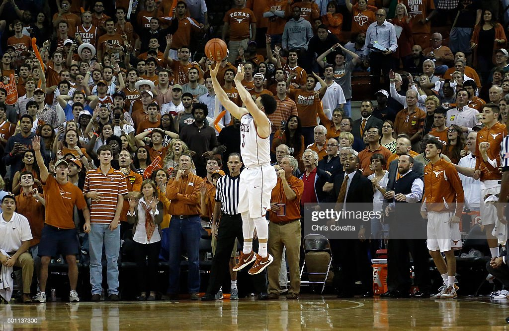Javan Felix of the Texas Longhorns shoots a jump shot at the buzzer to beat the North Carolina Tar Heels at the Frank Erwin Center on December 12...