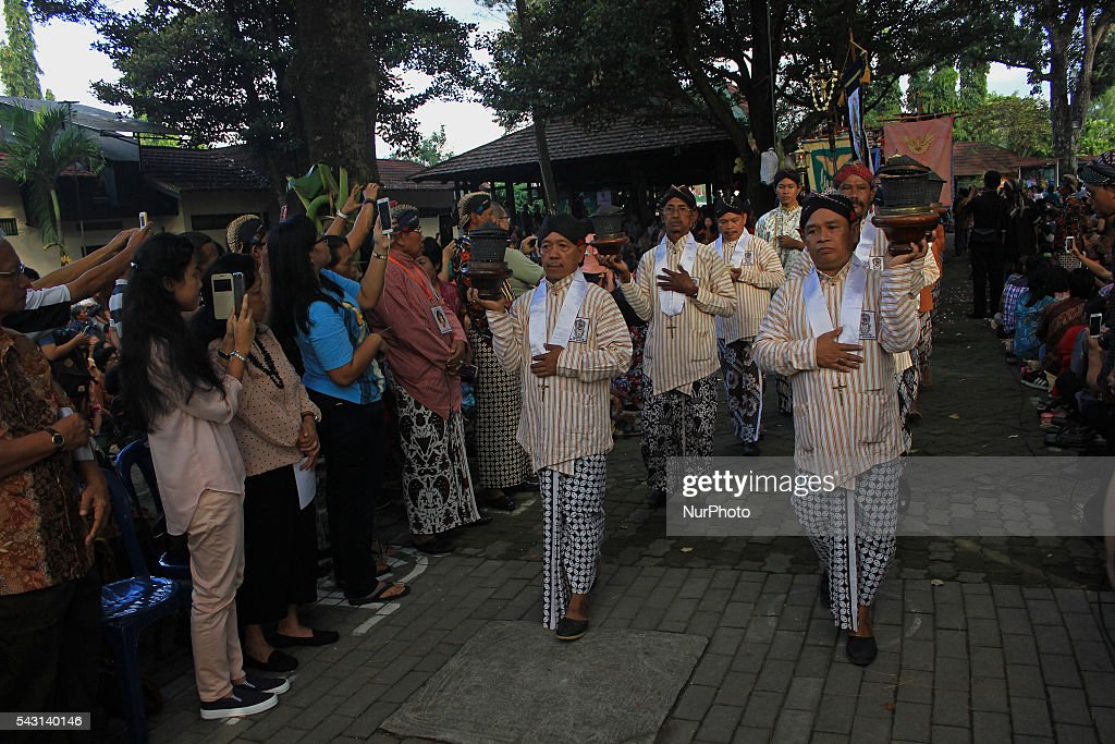 Javanese Catholics wearing traditional clothes during High Mass procession in the Hati Kudus Tuhan Yesus (HKTY) Ganjuran church at Bantul, Yogyakarta, Indonesia on June 26, 2016. The annual procession paraded the gunungan surrounding the church as an act of gratitude to the Lord for the blessings given to the people as well as the anniversary celebrations the Javanese Church that to 92 years. Ganjuran church has a mix of Javanese culture as the ordinances of worship.