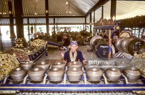 A Javanese court gamelan musician plays the bonang in the Court of the Sultan Yogyakarta Java Indonesia November 29 1989