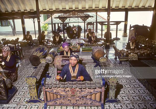 A Javanese court gamelan musician plays the gender in the Sultan's Court Yogyakarta Java Indonesia November 29 1989