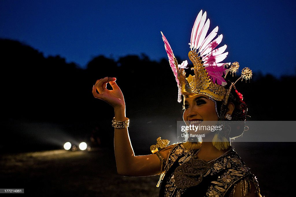 A Javanese dancer poses as she prepares ahead of a classical dance performance at Ratu Boko Temple on August 22, 2013 in Yogyakarta, Indonesia. To preserve ancient cultures, one of the observers of the arts and culture community Saptagama, conducts cultural shows 'Full Hamengku Boko', which feature classical performances and dance from Keraton Yogyakarta. The event is scheduled to be held regularly every full moon and will feature performances from the palaces of the archipelago every month. It will be held at Ratu Boko Temple, now known as an archaeological site.