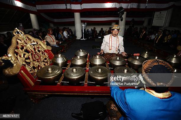 Javanese men play traditional music instrument Gamelan during Sekaten festival at Surakarta Mosque on January 14 2014 in Solo City Indonesia...