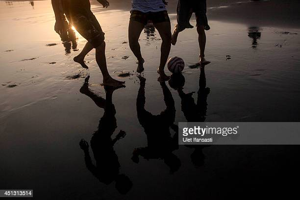 Javanese Muslims play football on the beach as they prepare for Ramadan with padusan ritual at Parangtritis beach on June 27 2014 in Yogyakarta...