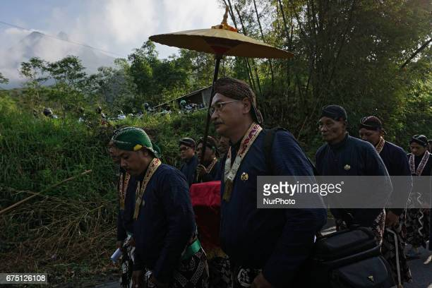 Javanese people follow the procession of Labuhan ceremony at Mount Merapi on April 28 2017 in Yogyakarta Indonesia The Labuhan Merapi ceremony is...