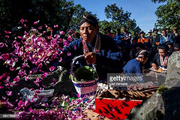 Javanese people pray during the Labuhan ceremony at Mount Merapi on May 31 2014 in Yogyakarta Indonesia The Labuhan Merapi ceremony is believed to...