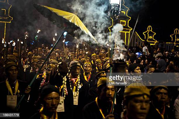 Javanese people walk during the rituals night carnival '1st Suro' during Islamic New Year celebrations at Kasunanan Palace on November 15 2012 in...