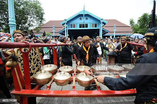 Javanese traditional music intruments gamelan accompany the Gunungan offering parade during Grebeg Maulud at Surakarta Mosque on January 14 2014 in...