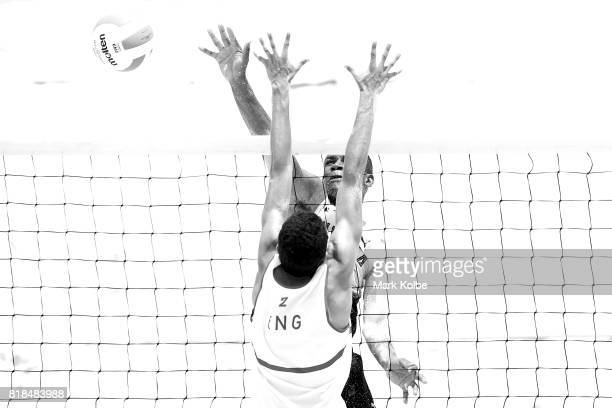 Javarie James of Jamaica spikes over Joaquin Bello of England as they compete in the Boys Beach Volleyball on day 1 of the 2017 Youth Commonwealth...