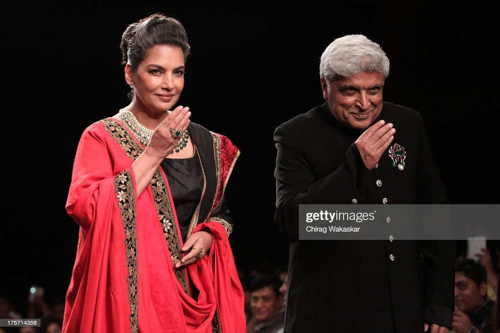 Javed Akhtar (R) and <a gi-track='captionPersonalityLinkClicked' href=/galleries/search?phrase=Shabana+Azmi&family=editorial&specificpeople=565786 ng-click='$event.stopPropagation()'>Shabana Azmi</a> (L) walk the runway at the Golecha's Jewels show on day 3 of India International Jewellery Week 2013 at the Hotel Grand Hyatt on August 6, 2013 in Mumbai, India.