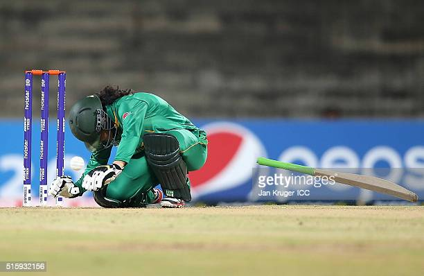 Javeria Khan of Pakistan collapses after being struck on the head of the bowling of Shamilia Connell of the West Indies during the Women's ICC World...