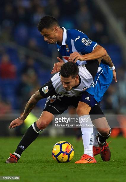 Javi Fuego of Espanyol competes for the ball with Santi Mina of Valencia during the La Liga match between Espanyol and Valencia at CornellaEl Prat...
