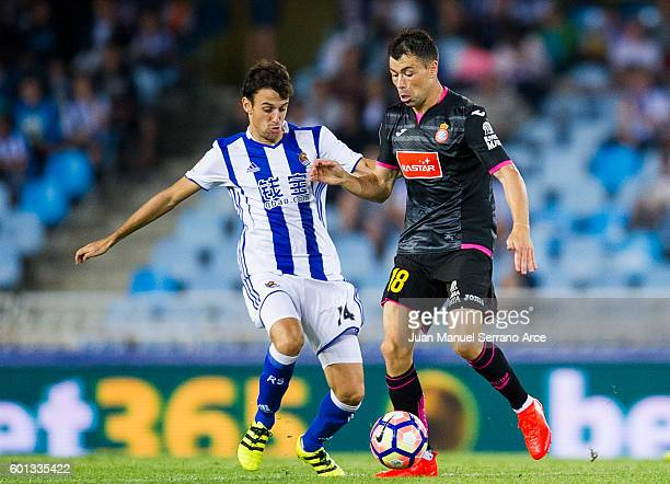 Javi Fuego of RCD Espanyol duels for the ball with Ruben Pardo of Real Sociedad during the La Liga match between Real Sociedad de Futbol and RCD...