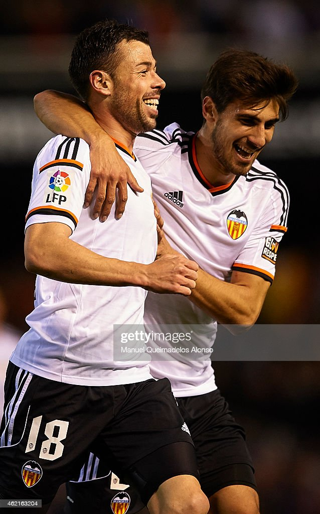 Javi Fuego (L) of Valencia celebrate scoring with his teammate Andre Gomes during the La Liga match between Valencia CF and Sevilla FC at Estadi de Mestalla on January 25, 2015 in Valencia, Spain.