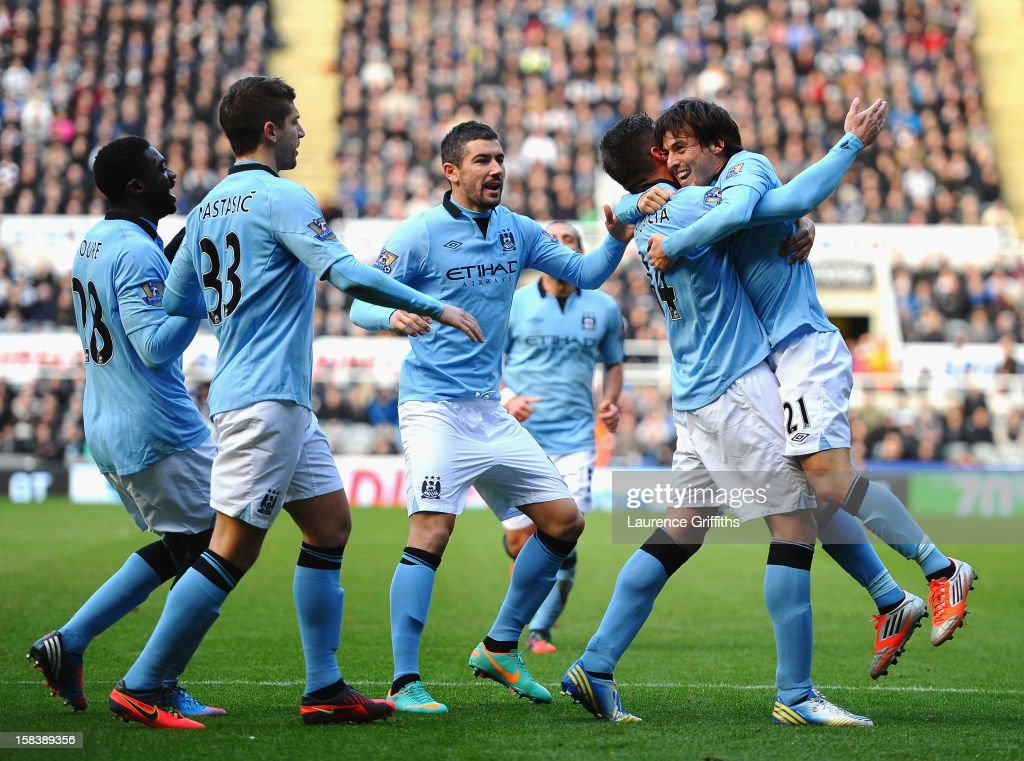 Javi Garcia and <a gi-track='captionPersonalityLinkClicked' href=/galleries/search?phrase=David+Silva&family=editorial&specificpeople=675795 ng-click='$event.stopPropagation()'>David Silva</a> of Manchester City celebrate the second goal during the Barclays Premier League match between Newcastle United and Manchester City at St James' Park on December 15, 2012 in Newcastle upon Tyne, England.