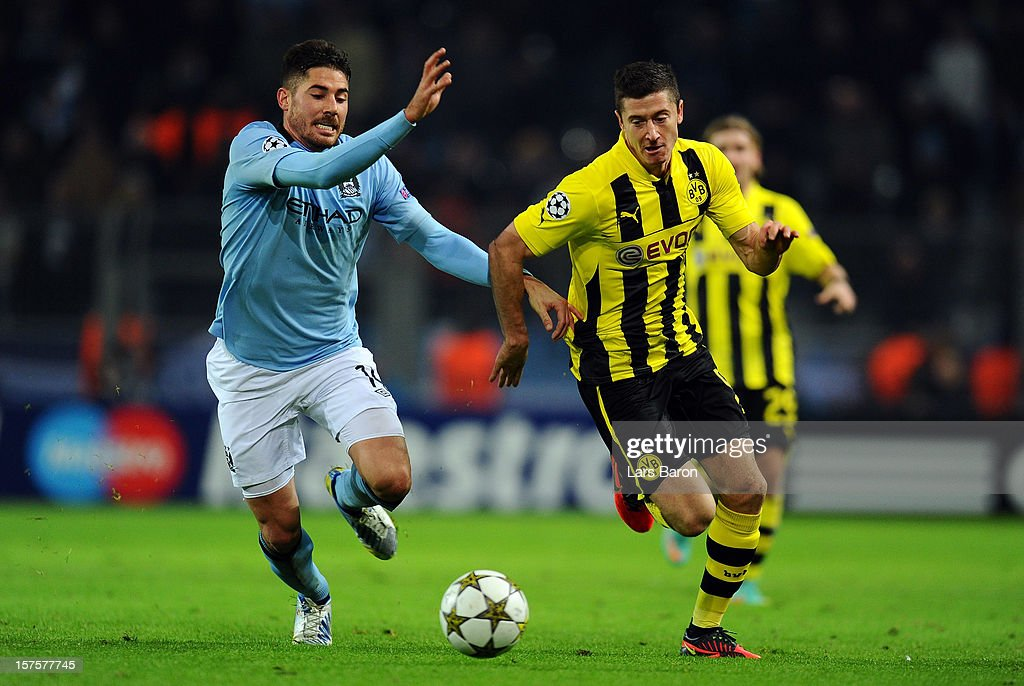 Javi Garcia of Manchester challenges <a gi-track='captionPersonalityLinkClicked' href=/galleries/search?phrase=Robert+Lewandowski&family=editorial&specificpeople=5532633 ng-click='$event.stopPropagation()'>Robert Lewandowski</a> of Dortmund during the UEFA Champions League group D match between Borussia Dortmund and Manchester City at Signal Iduna Park on December 4, 2012 in Dortmund, Germany.