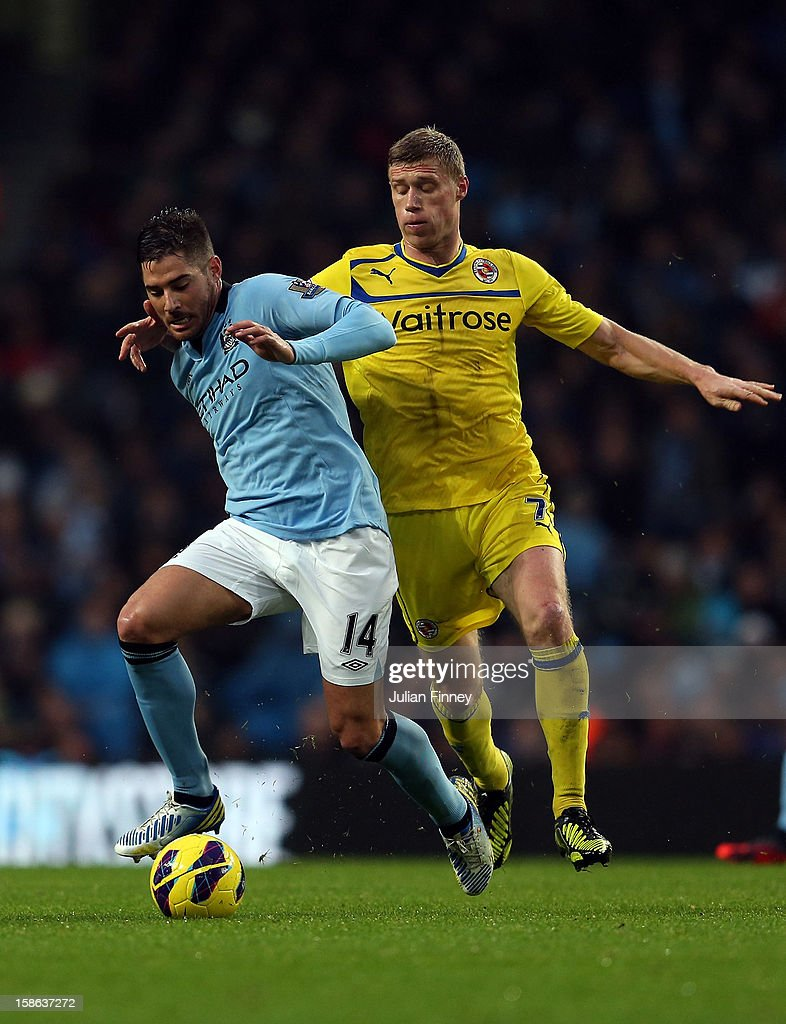 Javi Garcia of Manchester City holds off the challenge by <a gi-track='captionPersonalityLinkClicked' href=/galleries/search?phrase=Pavel+Pogrebnyak&family=editorial&specificpeople=864025 ng-click='$event.stopPropagation()'>Pavel Pogrebnyak</a> of Reading during the Barclays Premier League match between Manchester City and Reading at Etihad Stadium on December 22, 2012 in Manchester, England.