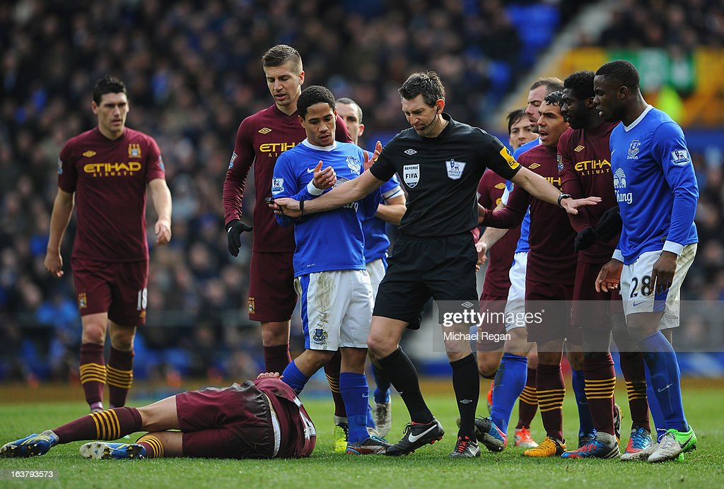 Javi Garcia of Manchester City reacts to a challenge from <a gi-track='captionPersonalityLinkClicked' href=/galleries/search?phrase=Steven+Pienaar&family=editorial&specificpeople=787271 ng-click='$event.stopPropagation()'>Steven Pienaar</a> of Everton which earned him a red card during the Barclays Premier League match between Everton and Manchester City at Goodison Park on March 16, 2013 in Liverpool, England.