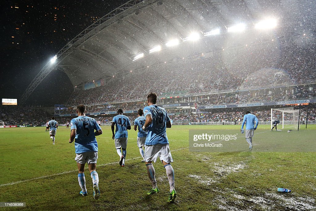 Javi Garcia #14 of Manchester City runs onto the pitch for the start of the second half during the Barclays Asia Trophy Final match between Manchester City and Sunderland at Hong Kong Stadium on July 27, 2013 in So Kon Po, Hong Kong.