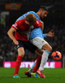 Javi Garcia of Manchester City tangles with Chris Taylor of Blackburn Rovers during the Budweiser FA Cup Third Round Replay match between Manchester...