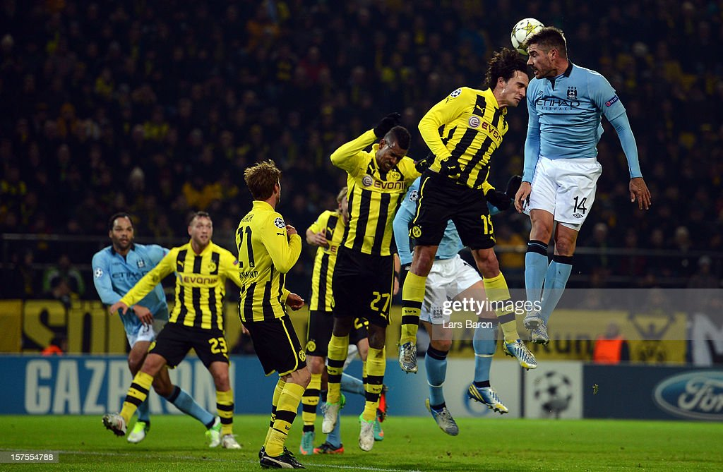 Javi Garcia of Manchester goes up for a header with <a gi-track='captionPersonalityLinkClicked' href=/galleries/search?phrase=Mats+Hummels&family=editorial&specificpeople=595395 ng-click='$event.stopPropagation()'>Mats Hummels</a> of Dortmund during the UEFA Champions League group D match between Borussia Dortmund and Manchester City at Signal Iduna Park on December 4, 2012 in Dortmund, Germany.