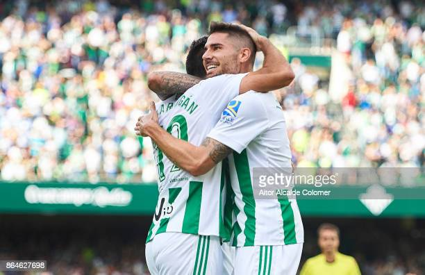 Javi Garcia of Real Betis Balompie celebrates after scoring Arnaldo Antonio Sanabria the first goal for Real Betis Balompie with Antonio Barragan of...