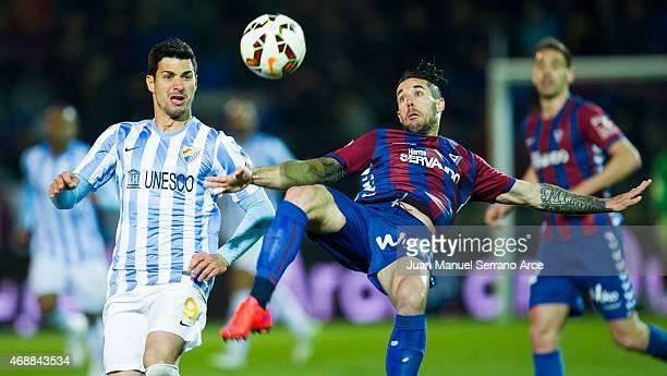Javi Guerra of Malaga FC duels for the ball with Manuel Castellano ÔLillo' of SD Eibar during the La Liga match between SD Eibar and Malaga FC at...