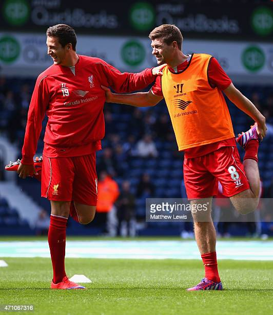 Javi Manquillo and Steven Gerrard of Liverpool stretch during the Barclays Premier League match between West Bromwich Albion and Liverpool at The...