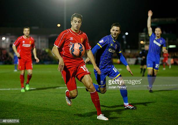 Javi Manquillo of Liverpool controls the ball as Callum Kennedy of AFC Wimbledon closes in during the FA Cup Third Round match between AFC Wimbledon...