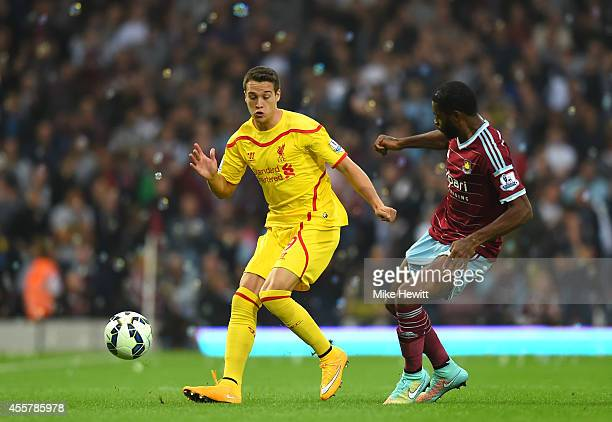 Javi Manquillo of Liverpool is challenged by Alexandre Song of West Ham during the Barclays Premier League match between West Ham United and...