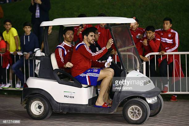 Javi Martinez and Xabi Alonso leave leave the training in a golf cart during day 2 of the Bayern Muenchen training camp at ASPIRE Academy for Sports...