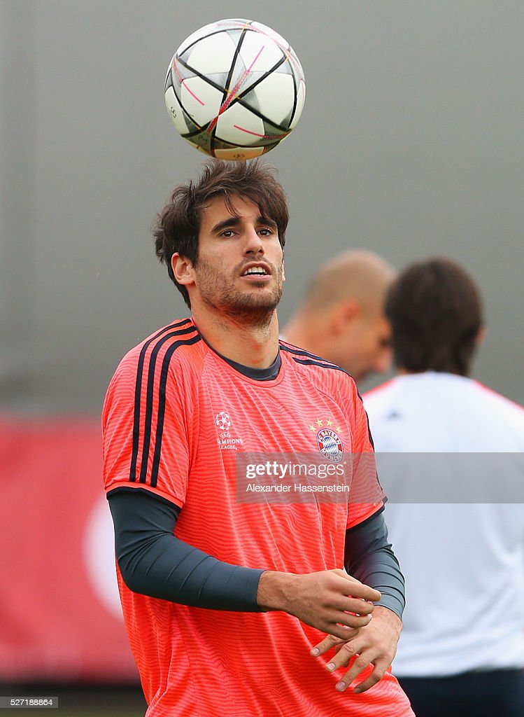 Javi Martinez heads the ball during a FC Bayern Muenchen training session ahead of their UEFA Champions League semi final second leg match against Club Atletico de Madrid at the Saebener Strasse training ground on May 2, 2016 in Munich, Germany.