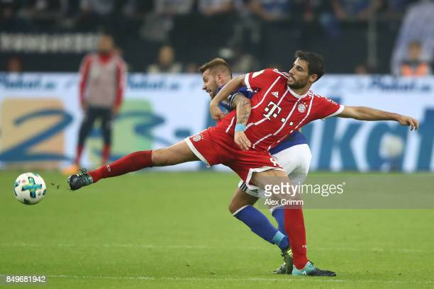 Javi Martinez of Bayern Muenchen fights for the ball with Guido Burgstaller of Schalke during the Bundesliga match between FC Schalke 04 and FC...