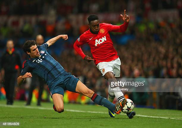 Javi Martinez of Bayern Muenchen tackles Danny Welbeck of Manchester United during the UEFA Champions League Quarter Final first leg match between...