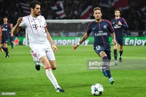 Javi Martinez of Bayern Munich and Neymar Jr of PSG during the Uefa Champions League match between Paris Saint Germain and Fc Bayern Muenchen on...