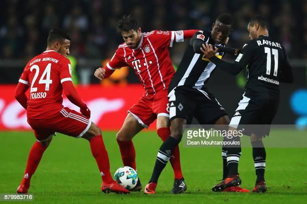 Javi Martinez of Bayern Munich battles for the ball with Denis Zakaria of Borussia Monchengladbach during the Bundesliga match between Borussia...