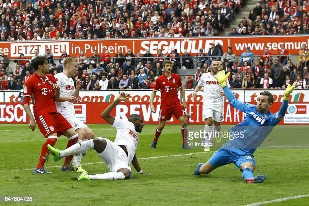 Javi Martinez of Bayern Munich scores Frederik Sorensen of 1FC Koln Anthony Modeste of 1FC Koln Thomas Muller of Bayern Munich Thomas Kessler of 1FC...