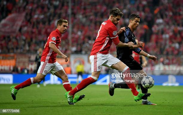 Javi Martinez of Muenchen and Cristiano Ronaldo of Real Madrid battle for the ball during the UEFA Champions League Quarter Final first leg match...