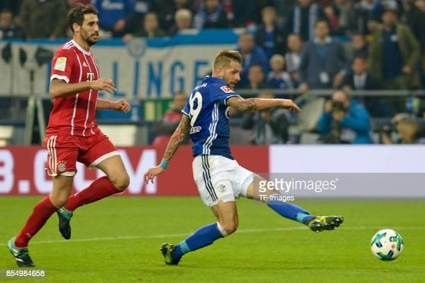 Javi Martinez of Muenchen and Guido Burgstaller of Schalke battle for the ball during the Bundesliga match between FC Schalke 04 and FC Bayern...